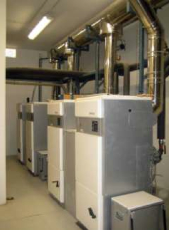 Picture 8 –  The four biomass  boilers supplying the  IAS Gestion Building