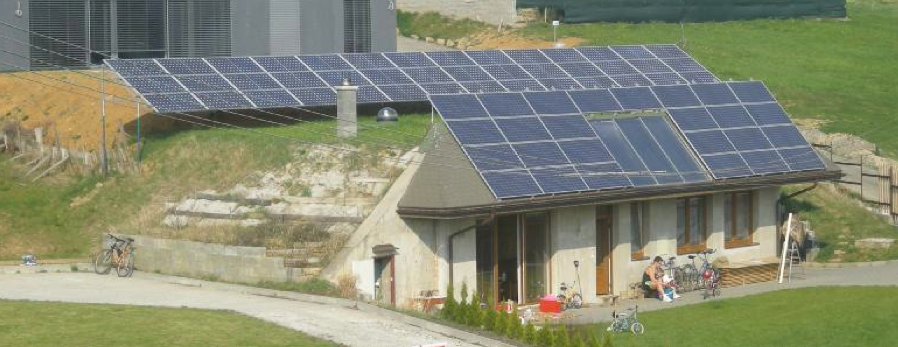 Picture 1 –  Earth-sheltered house  with photovoltaics  and solar thermal  collectors